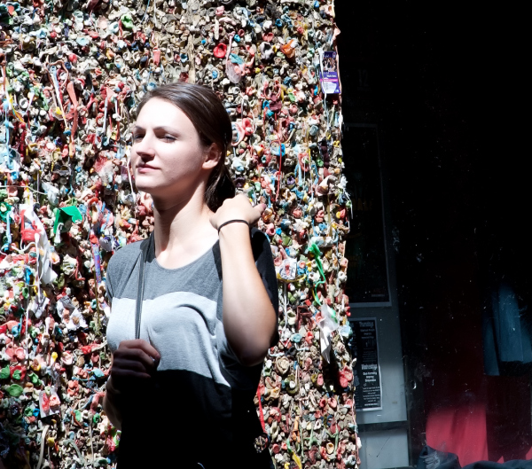 In front of the gum wall.
