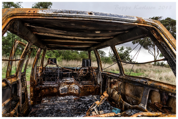 Wreckage of burnt out van outside Melton, VIC