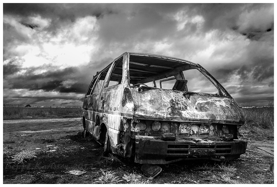 Wreckage of burnt out van outside Melton, VIC