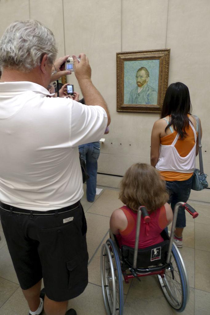 Tourist taking picture of  Van Gogh self portrait