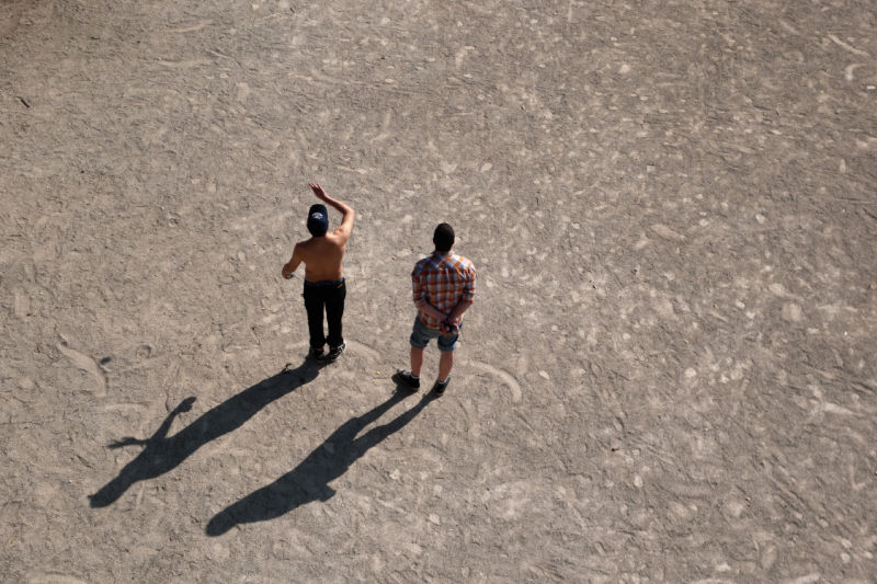 Pétanque players on the sun