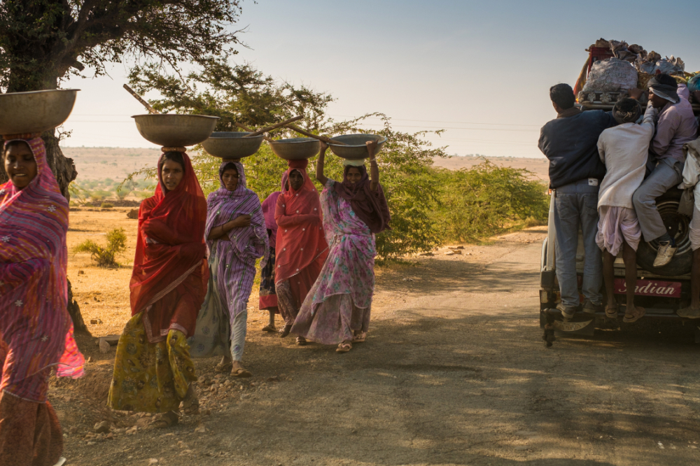 men crossing women on the road to Bundi