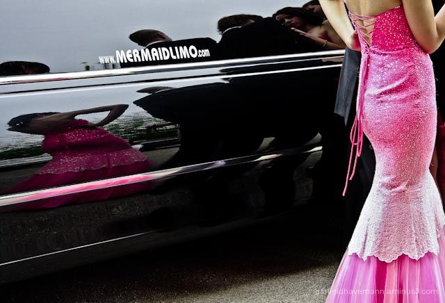 A young woman's dress reflect mermaid like on limo