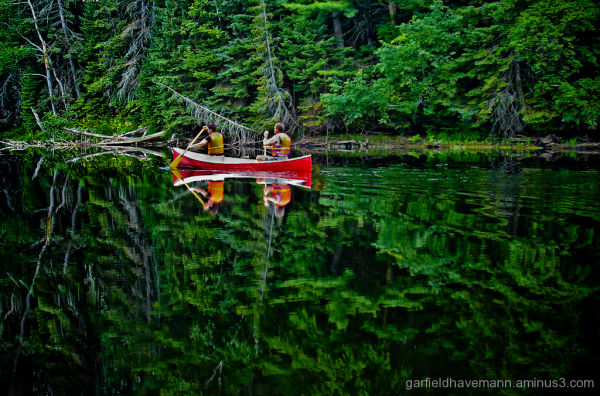 Early evening canoeing on Muskoka River reflection