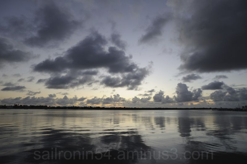 sunrise clouds and water