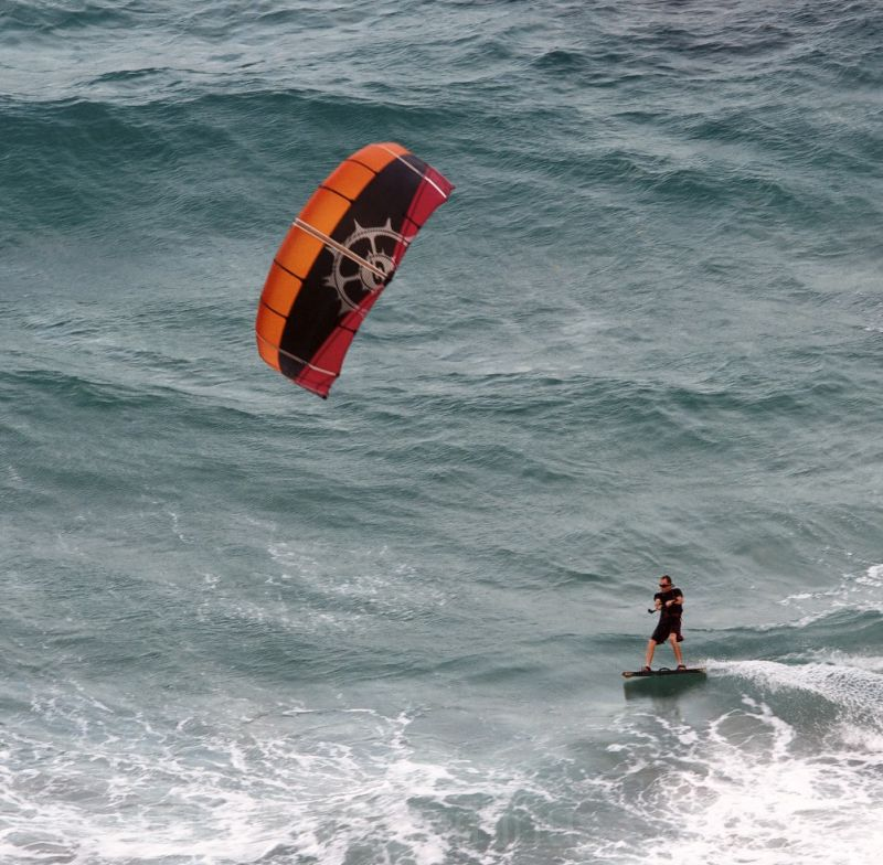 Kite surfer on deep blue ocean