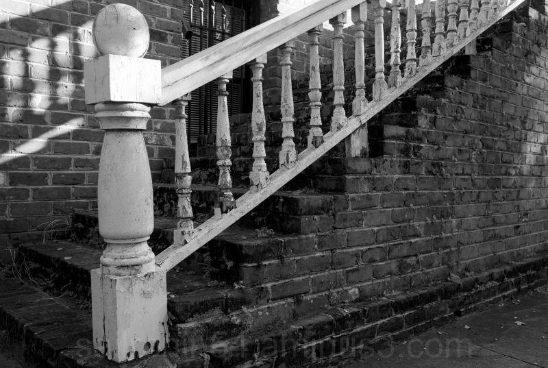 Savannah house with wooden rail
