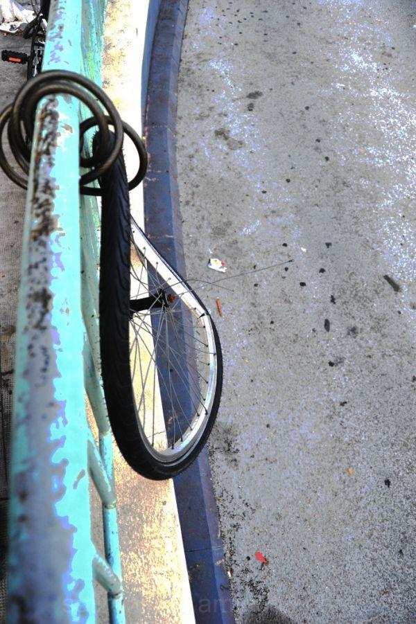 Stolen bicycle bent wheel rail