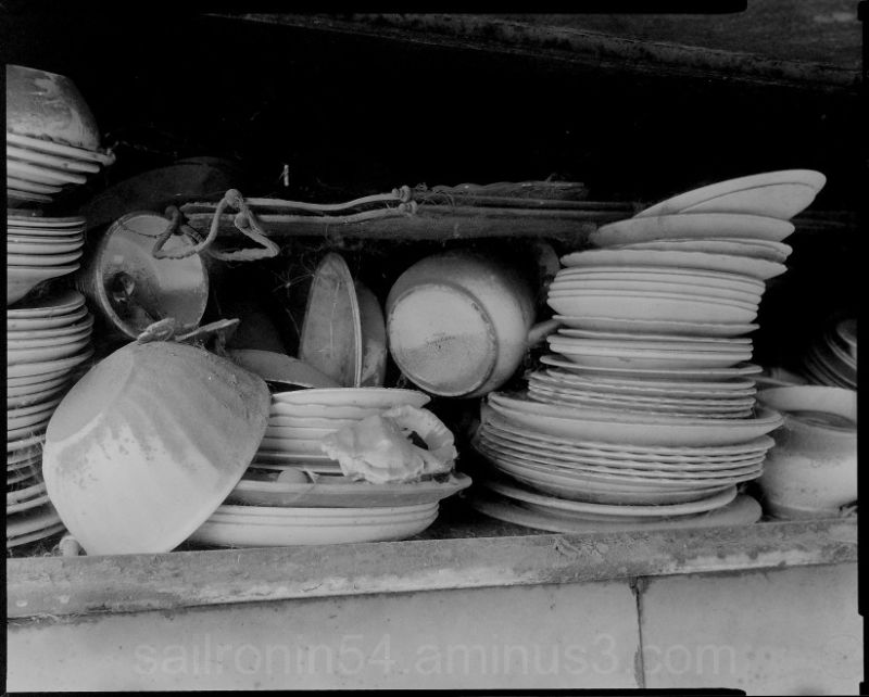 Dusty dishes in abandoned barn