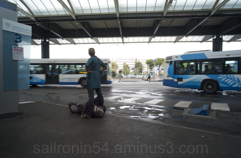 Woman Waiting at the Nice airport bus station