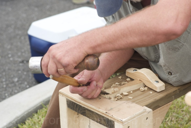 Wood carver at work closeup hands chisel