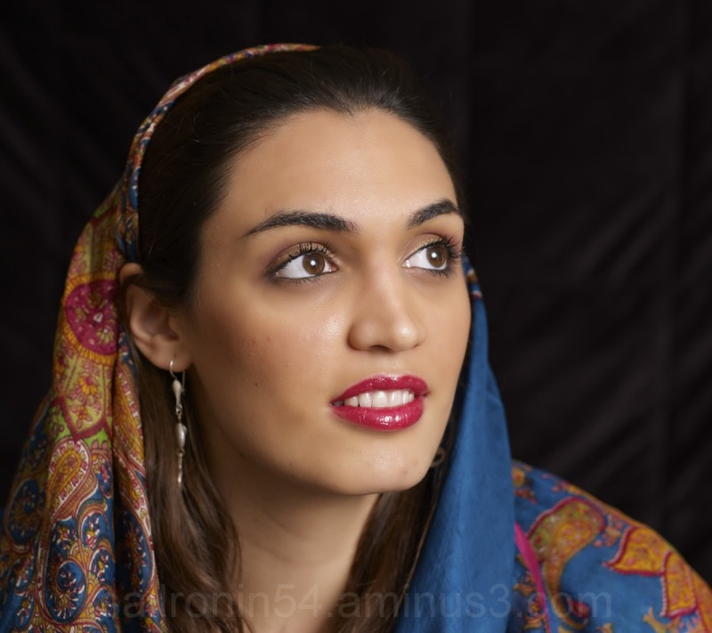 Iranian woman with scarf and red lipstick