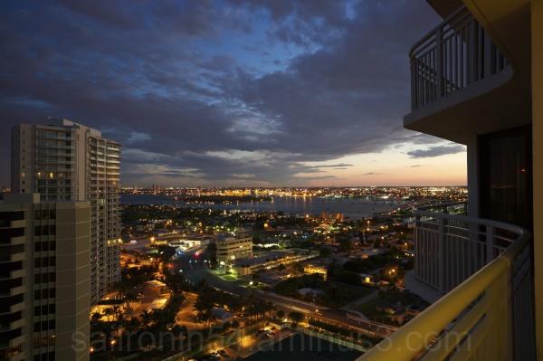 City lights and Peanut Island from condo balcony
