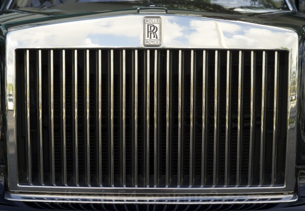 detail shot of Rolls Royce grill with reflections