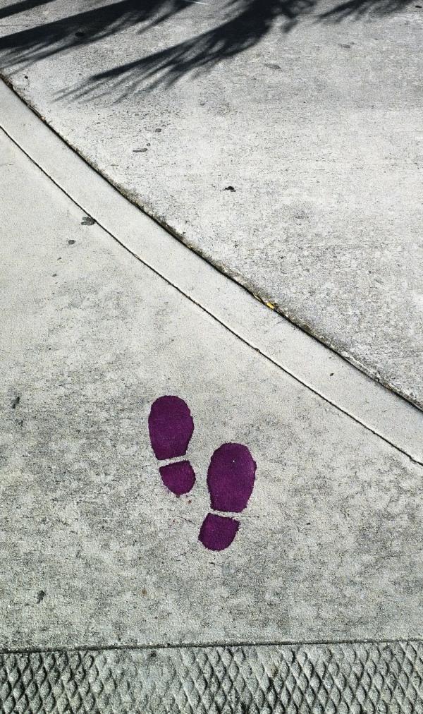 Sidewalk with painted footprints in Northwood, FL