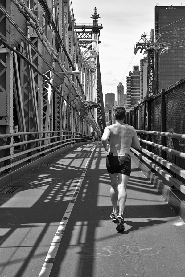Running across the 59th Street bridge