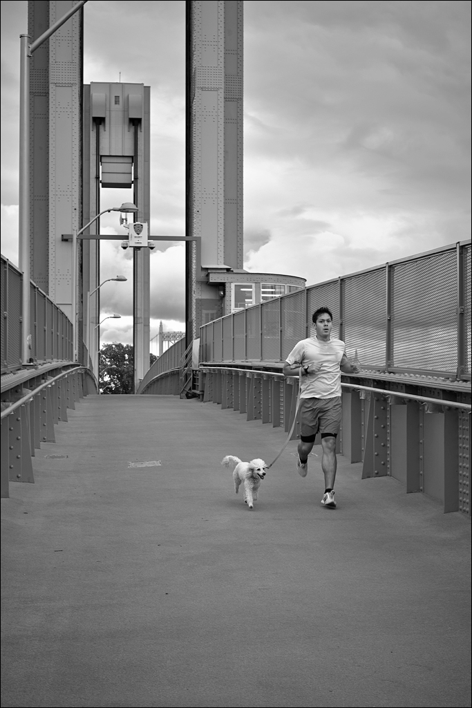 Running across the 103rd Street footbridge