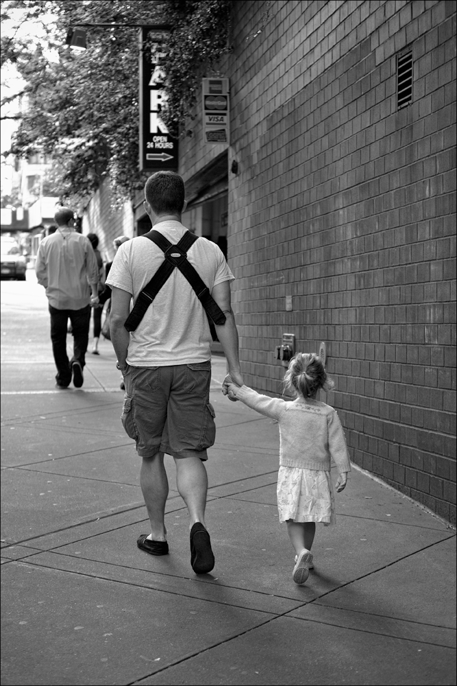 Father and daughter walking...