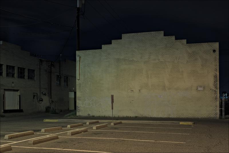 Brick wall & parking lot