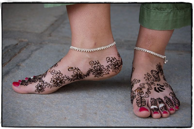 My feet adorned with toe rings, anklets, and Henna