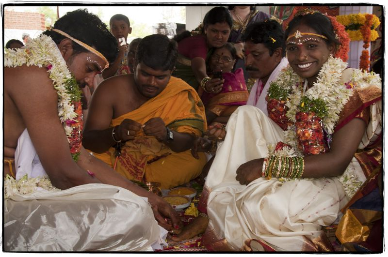 Putting on toes; a symbol of an Indian marriage