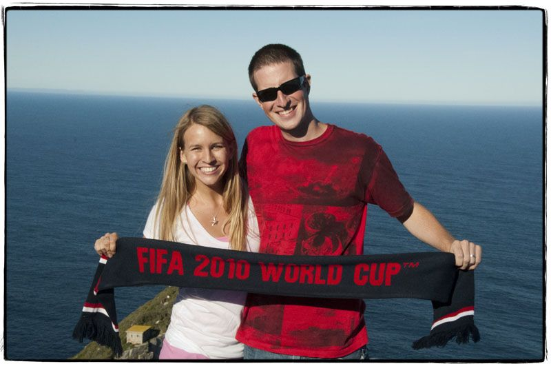 Holding our USA scarf on Cape Point, South Africa