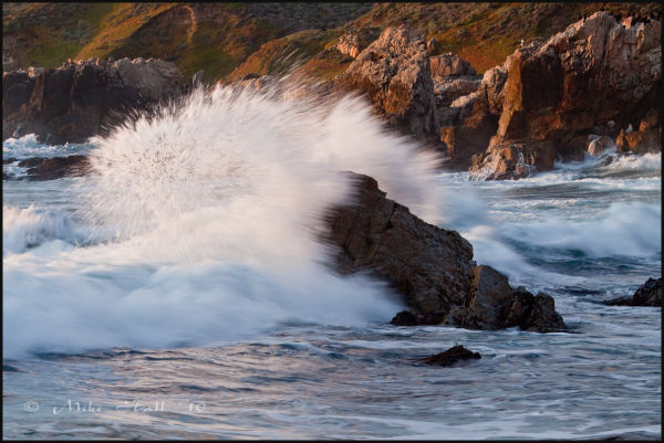 Waves splash on an outcrop of rock at Sobranes Pt.