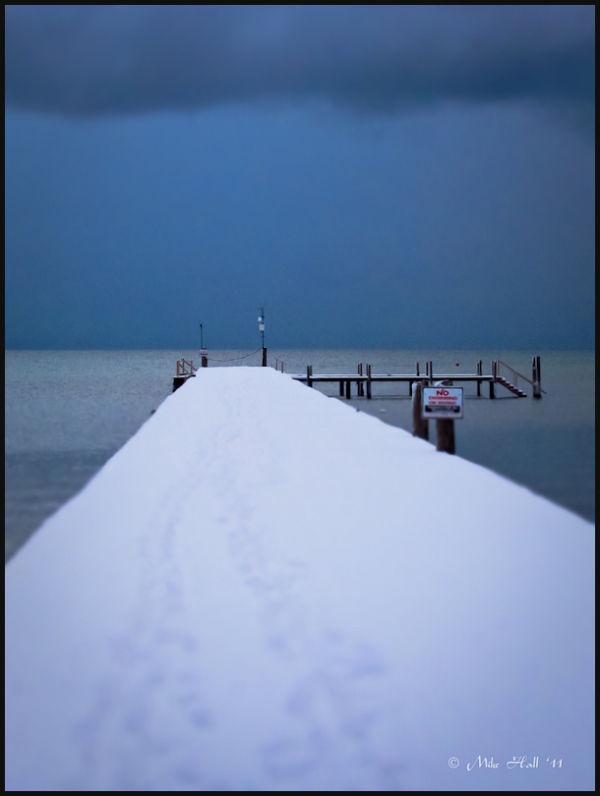 Snow covered pier on Lake Tahoe