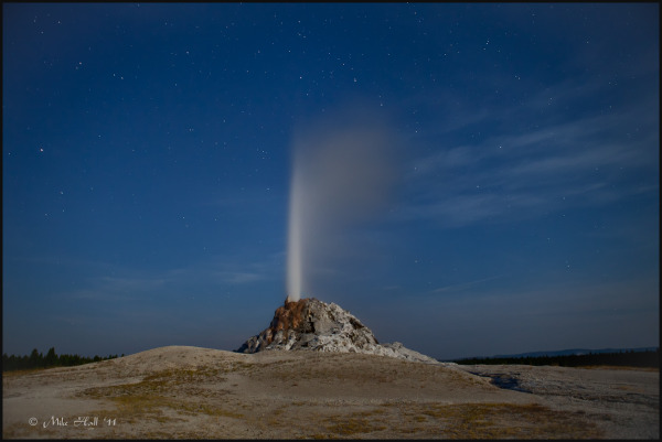 White Dome Geyser erupting at night, Yellowstone