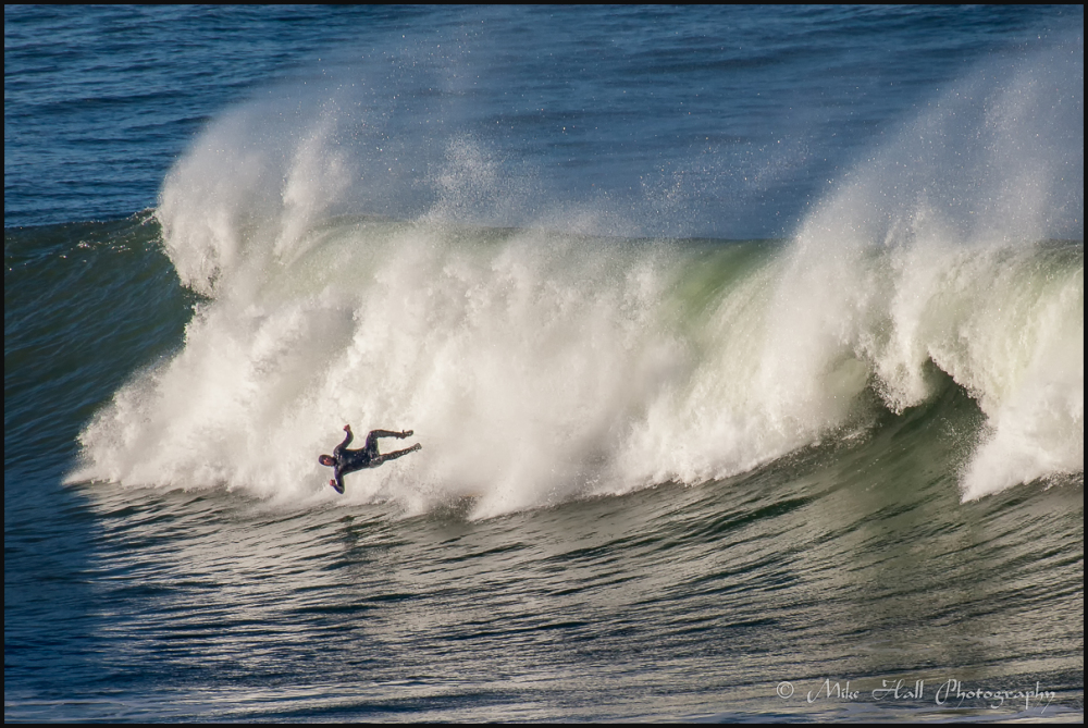 Surfer wipeout in Ross Cove, Half Moon Bay, CA