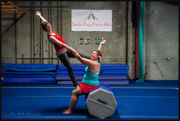 Acroyoga instructor and student