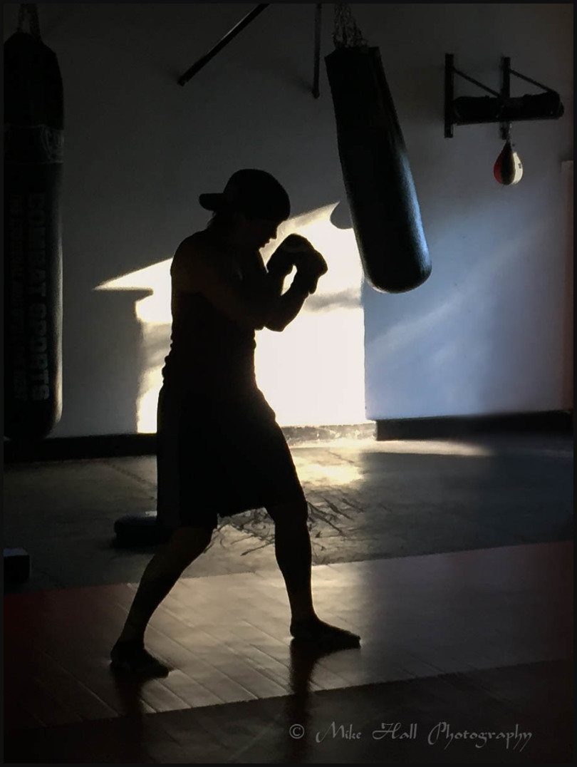 Female boxer warms up prior to a training session