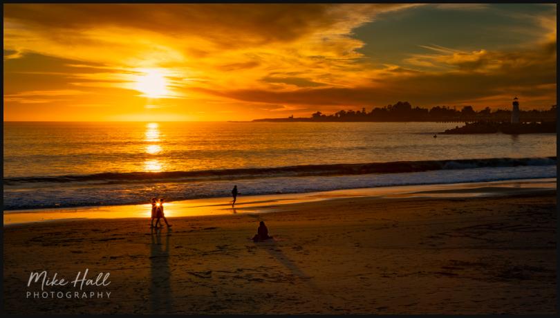 Outdoor lovers enjoy the setting sun in Santa Cruz