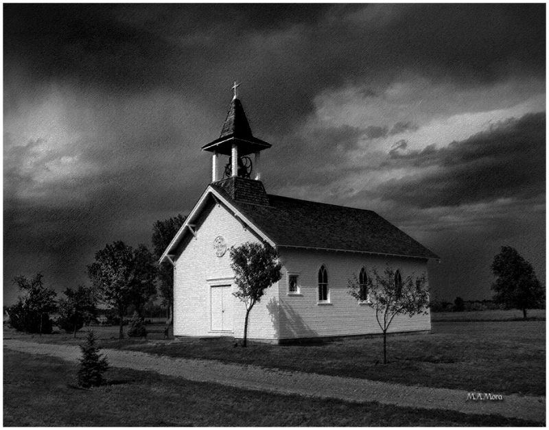 old country church in a summer storm
