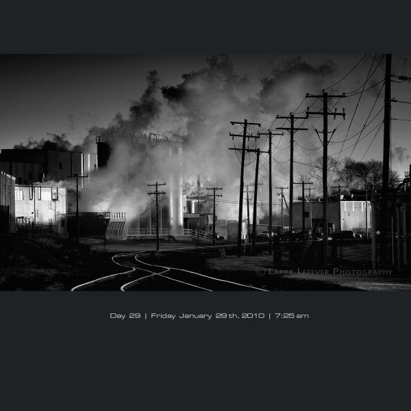 Factory emitting steam on frigid morning