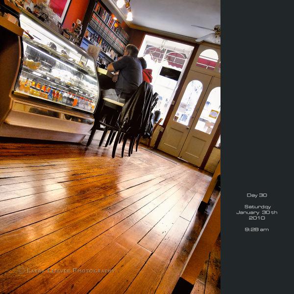 Aged hardwood floor in coffee shop.