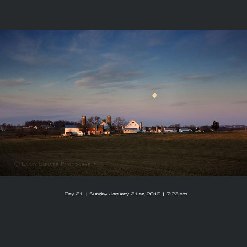 Moon setting over Amish farm.