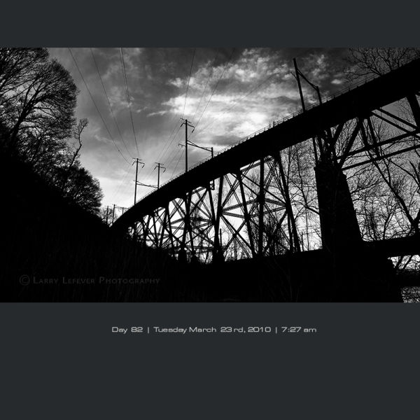 Train trestle with power lines.