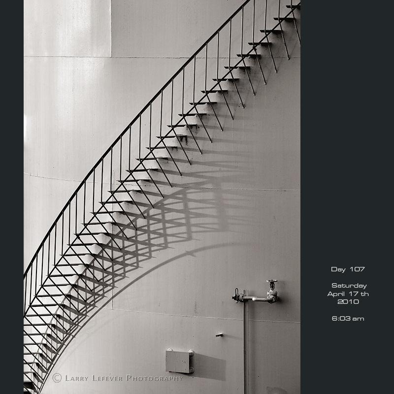 Spiral stairs on oil storage tank.