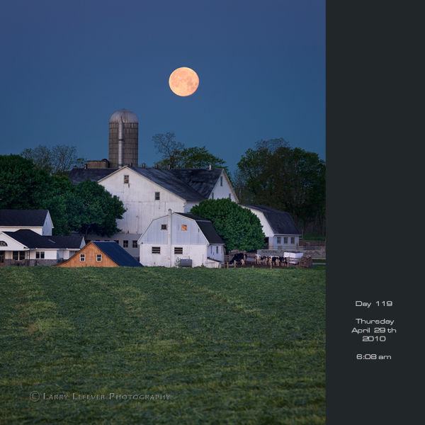 Full moon setting over dairy farm.
