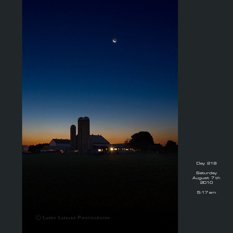Crescent moon over dairy farm