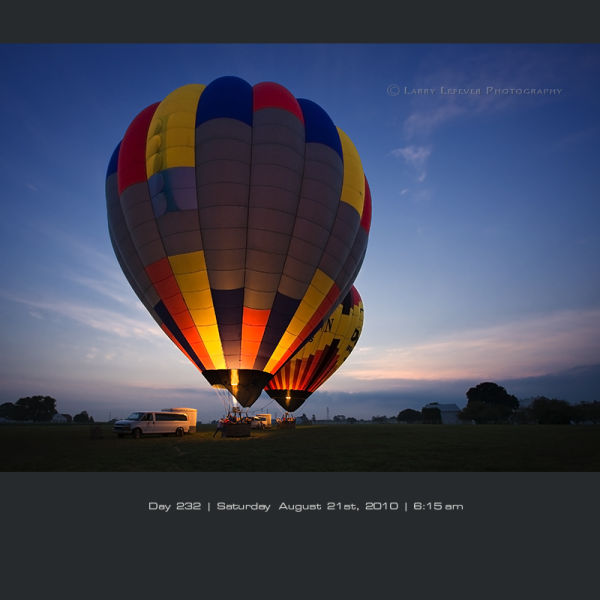 Hot air balloons taking off at dawn