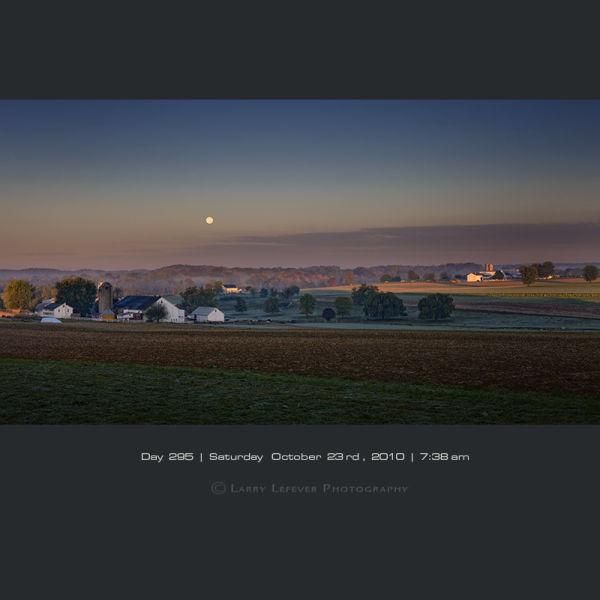 Moon setting over farmland