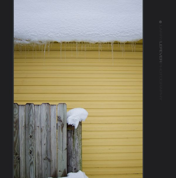 Snow and yellow building