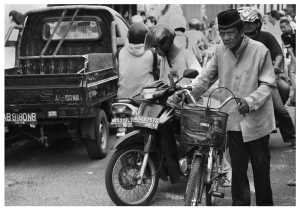old men with his bicycle at the market yogyakarta