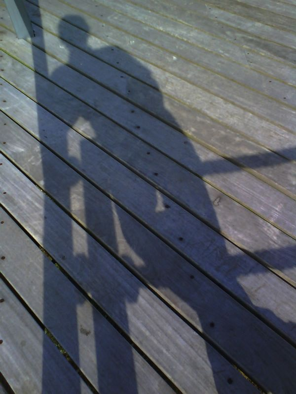 My shadow on a pier