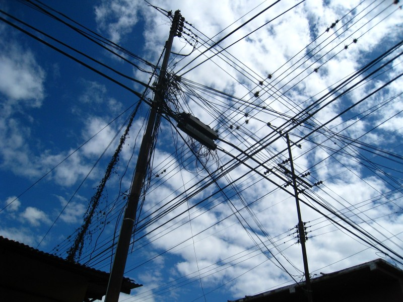 Power lines in contrast to the blue sky.