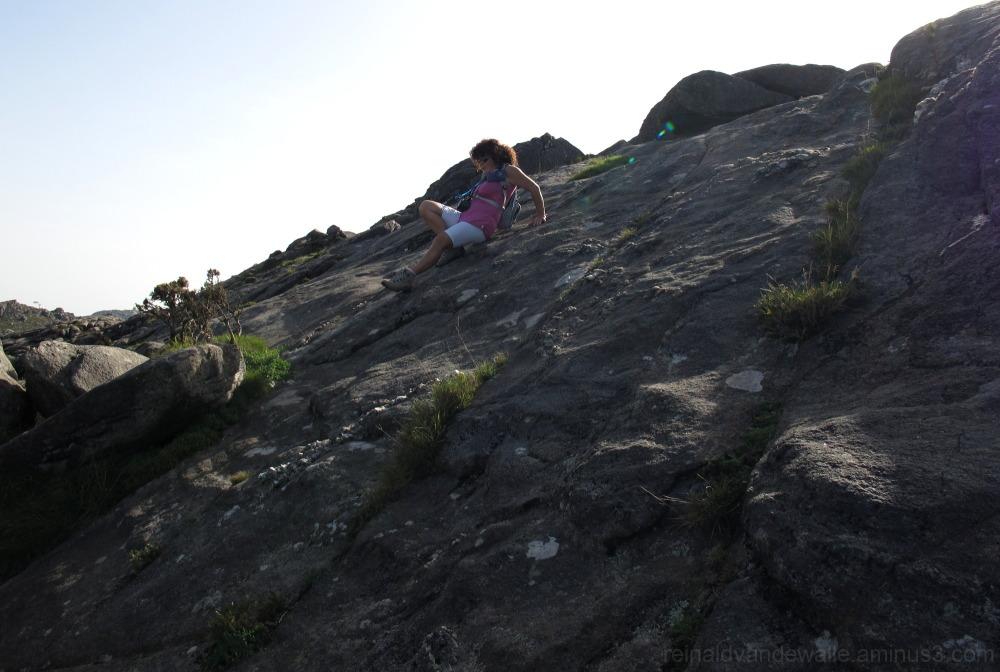 Hiker descending a rock
