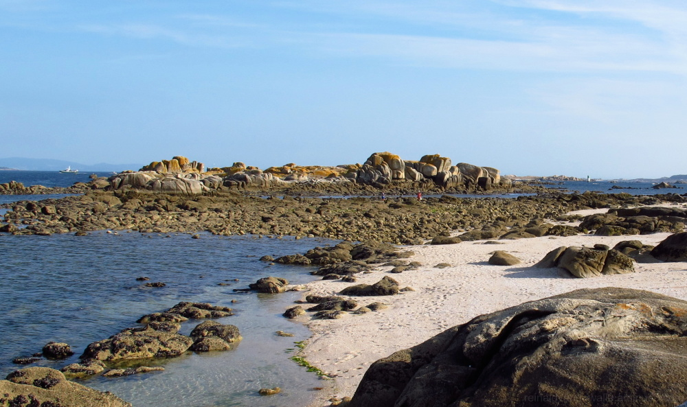 Low tide and rocks in sight.