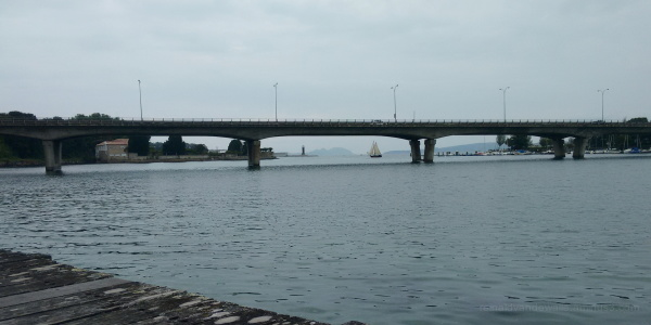 "Sailboat ""under"" a bridge"